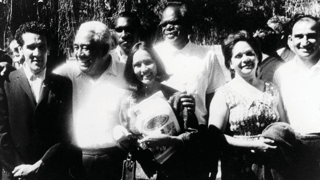 Black and white photo of a group of men and women.