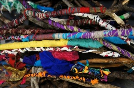 An image of sticks wrapped in brightly coloured string.