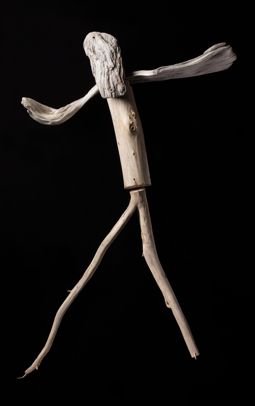 A figurative artwork made from driftwood, galvanised screws and copper wire. - click to view larger image