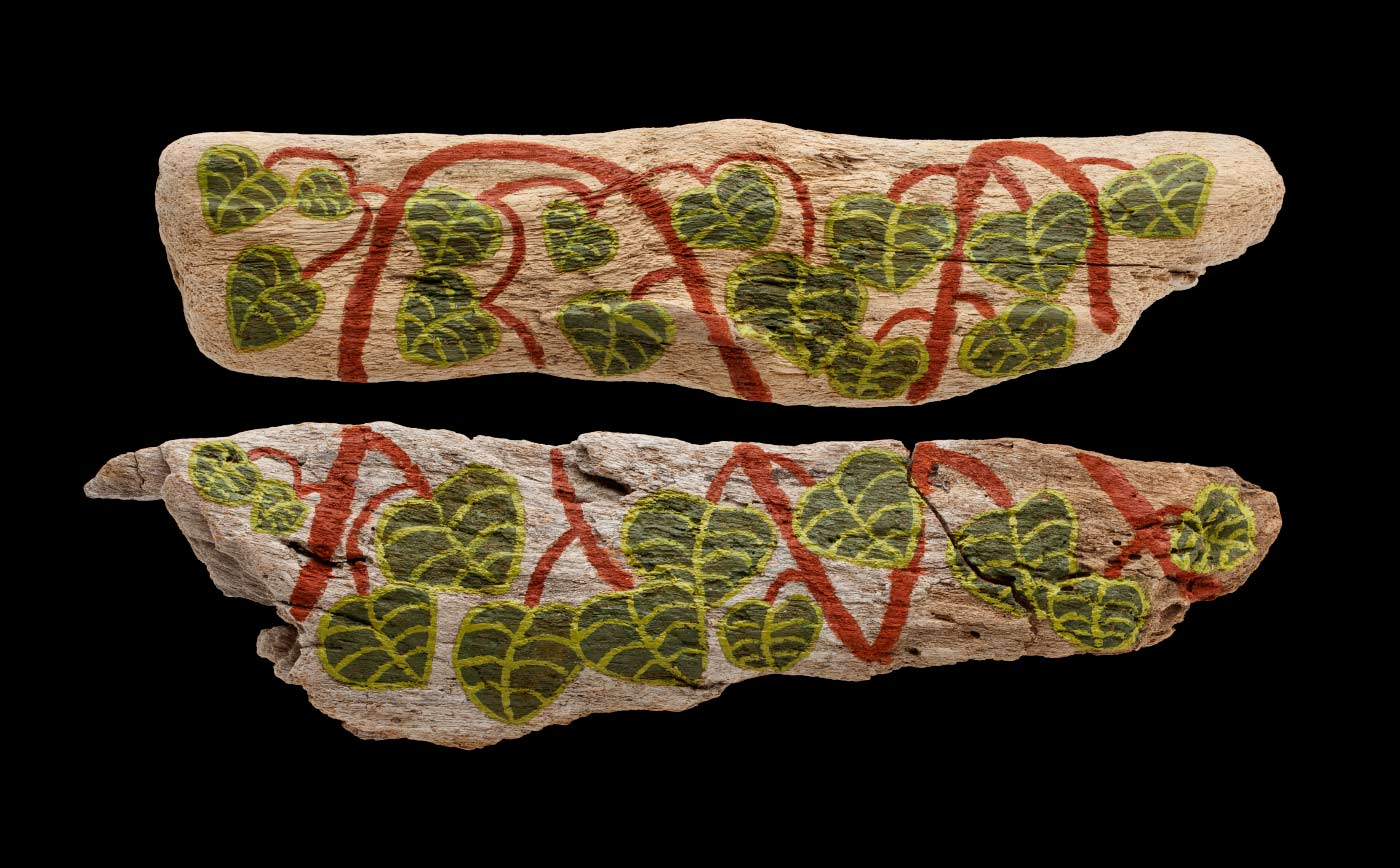 An acrylic painting on driftwood featuring green leaves with brown stems. - click to view larger image