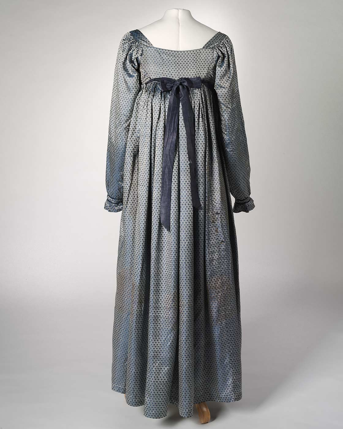 Back view of a blue silk full length empire-line dress. - click to view larger image