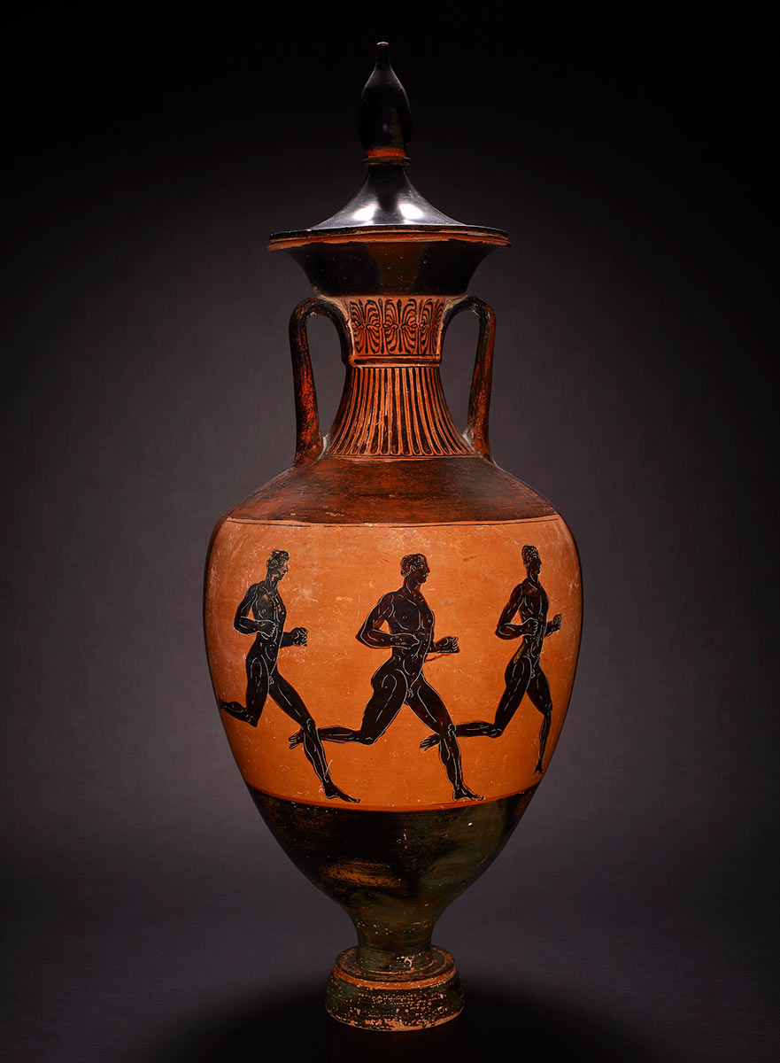 A tall vase with a tapered lid, engraved design on its neck, and an illustration of three black figures running. - click to view larger image