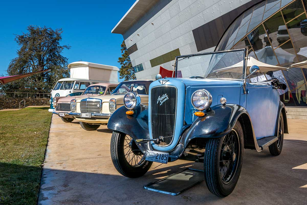Vintage cars on display on the exterior grounds of the National Museum of Australia. - click to view larger image