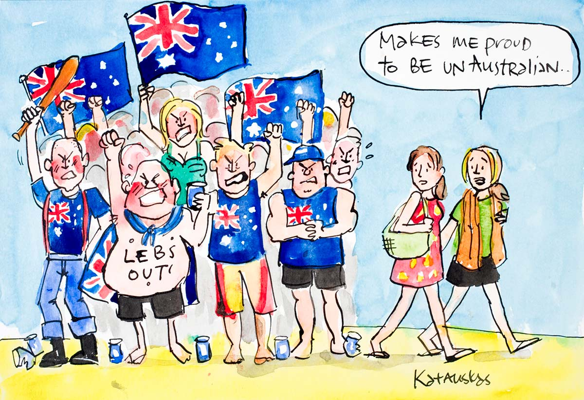 """Political cartoon featuring an angry racist crowd wearing and holding up Australian flags. Two women walk past, one saying """"MAKES ME PROUD TO BE UNAUSTRALIAN"""". - click to view larger image"""