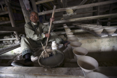 A man making ceramic bowls.