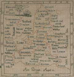 Image of sampler that shows how Ann Brown may have incorrectly joined England to France and Ireland because she mistook the cuts in a jigsaw map for borders