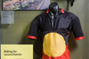 A display featuring Alby Clark's red, yellow and black bicyle outfit