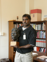 Thomas Amagula from Groote Eylandt holding a bronze head of his 'Grandfather' Kumbiala, held at the Smithsonian Institution, Washington DC.