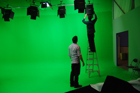 The crew set the levels and direction of the studio lights.