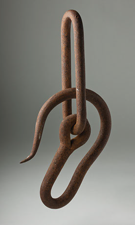 Rusted metal hook.