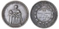 Photo showing two faces of a circular medallion, side by side. The face on the left has a raised image of a seated woman with two small children standing on either side and the text 'YOUTH IS THE SPRINGTIME OF LIFE SOW THEREFORE THAT YE MAY REAP', with 'Evan Jones, Sydney' at the base. Inscribed on the reverse is 'Awarded 'George T. Harvey./1st Prize./SecD.Cl 58./1881.'