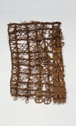 Apron made of coconut fibre, shell, fish teeth and scarlet feathers.