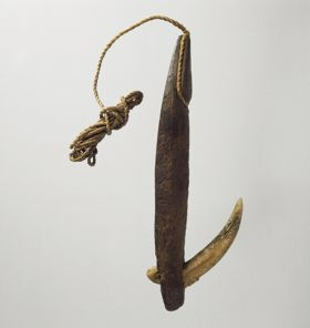 Fishhook with wooden shank, inserted bone point, and twisted cord as the line.