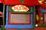 A colour photograph of a brightly decorated hatch in the Saw Doctor's wagon.  It includes a sign which reads 'DESTINY'.