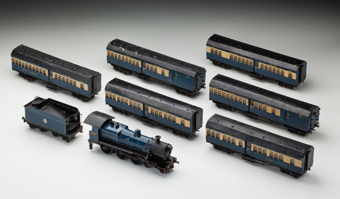 New South Wales Railways 35 class 'Caves Express' locomotive with tender and passenger cars, made of pressed and cast metals by Frank Fitzgerald