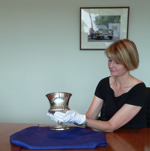 National Museum curator Kirsten Wehner holding the Junius Cup.