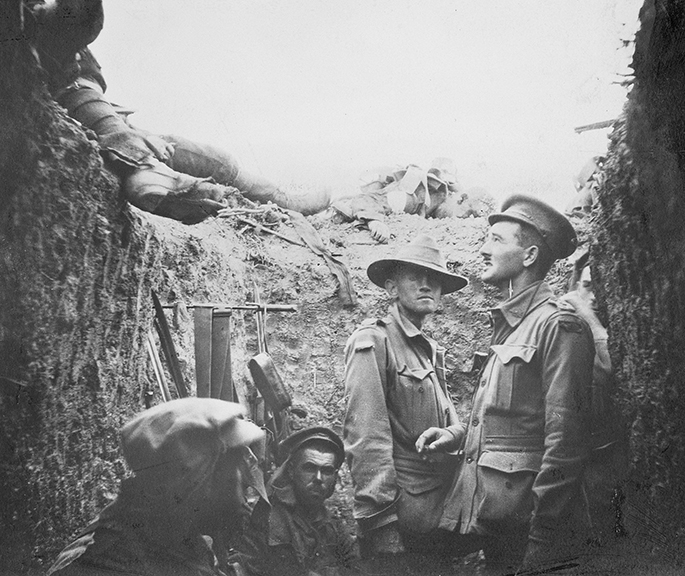 Black and white photo showing Australian soldiers in a trench