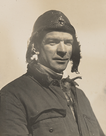 Portrait of Charles Ulm in flying hat.