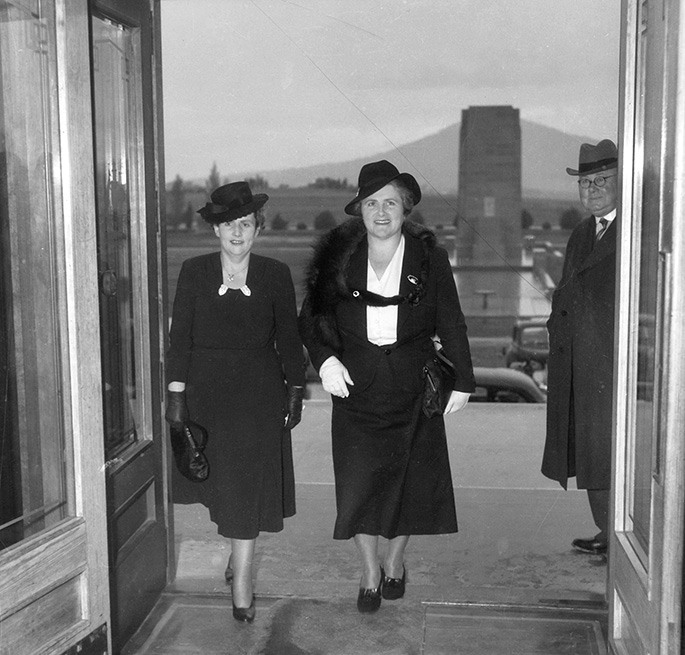 Two well-dressed women entering Parliament House in Canberra.