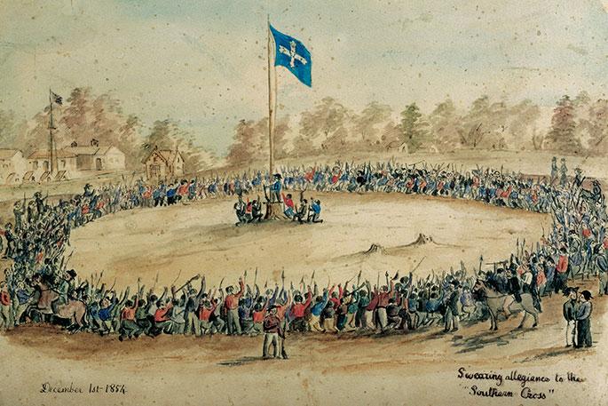 Hundreds of men encircle flag pole with Eureka flag at the top.
