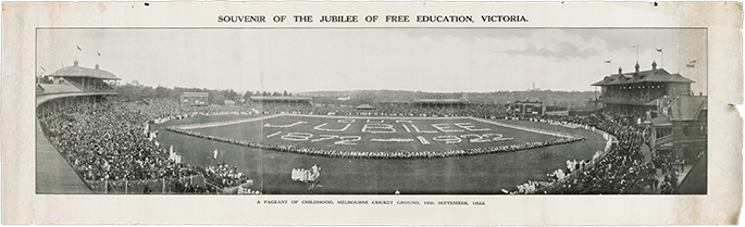 Panoramic black and white photograph of a large oval, possibly the MCG, with crowded stands. The words 'Jubilee 1872 – 1922' appear on the oval itself.