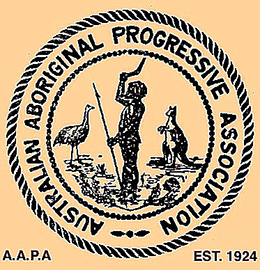 A stylised image of an Aboriginal man holding a spear and boomerang with an emu and kangaroo on either side. The words 'Australian Aboriginal Progressive Association' encircle the image