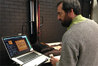 A man viewing an image on a laptop