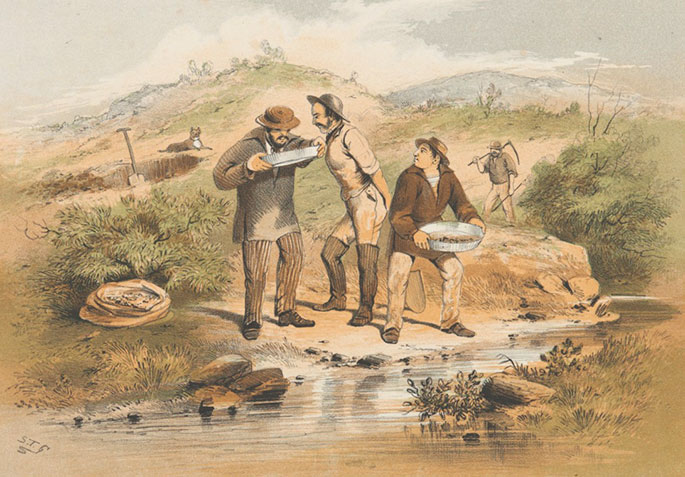Three men stand by a stream. Two are looking into a gold pan. In the background is a hole with a shovel in it, and a man carrying a hoe.