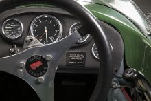 Detail image showing steering wheel and racing car instrument panel