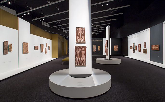 Indigenous artworks on display in an exhibition gallery.
