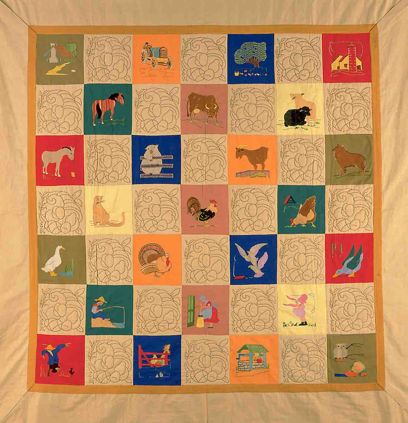 Quilt made from alternate quilted and embroidered squres depicting scenes of farm living and animals in the squares.