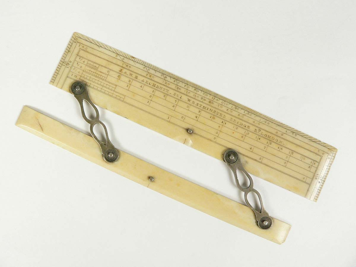 A hinged ruler from a set of drawing instruments.