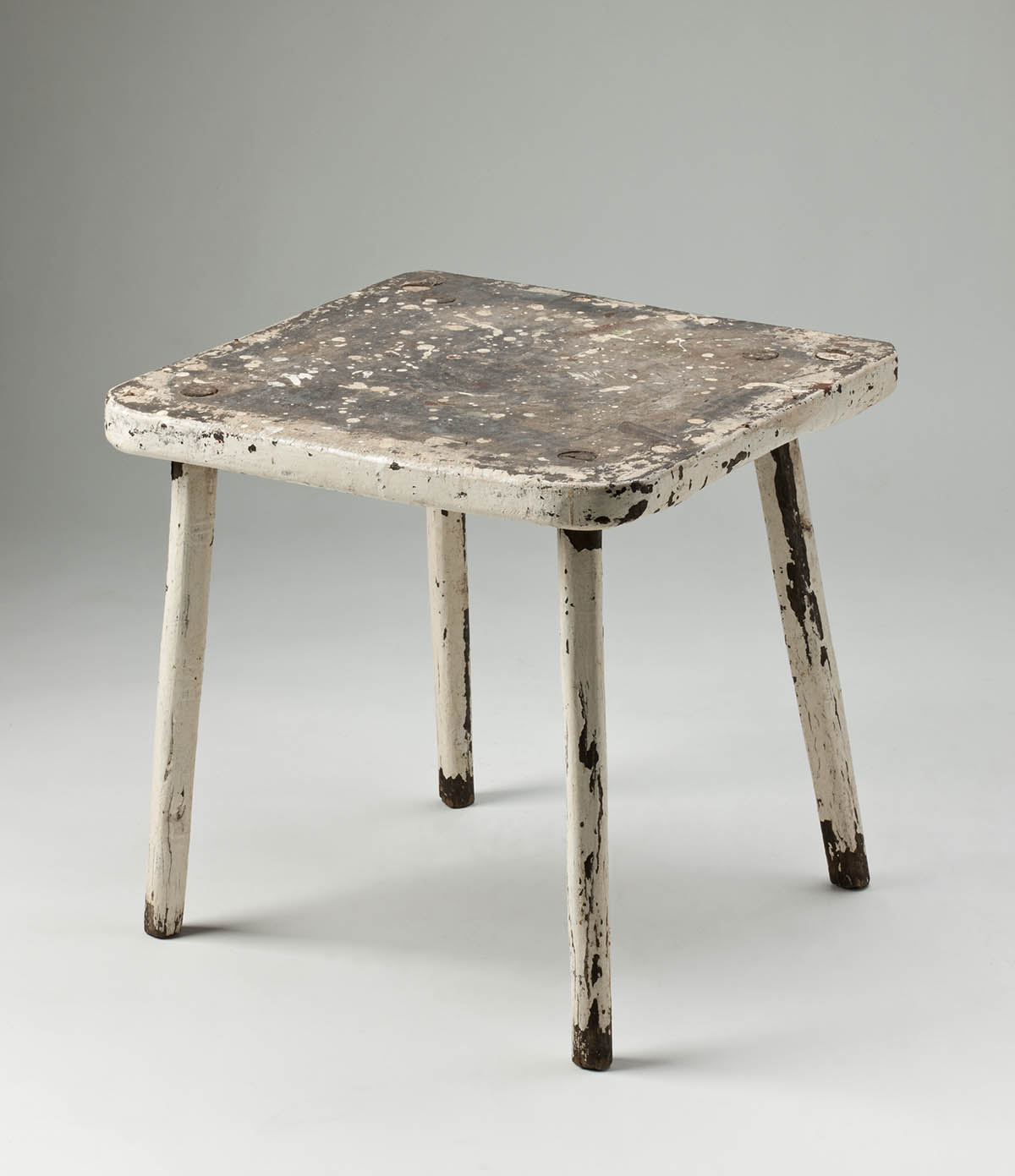 Wooden stool, painted cream, with four legs and a square seat. - click to view larger image