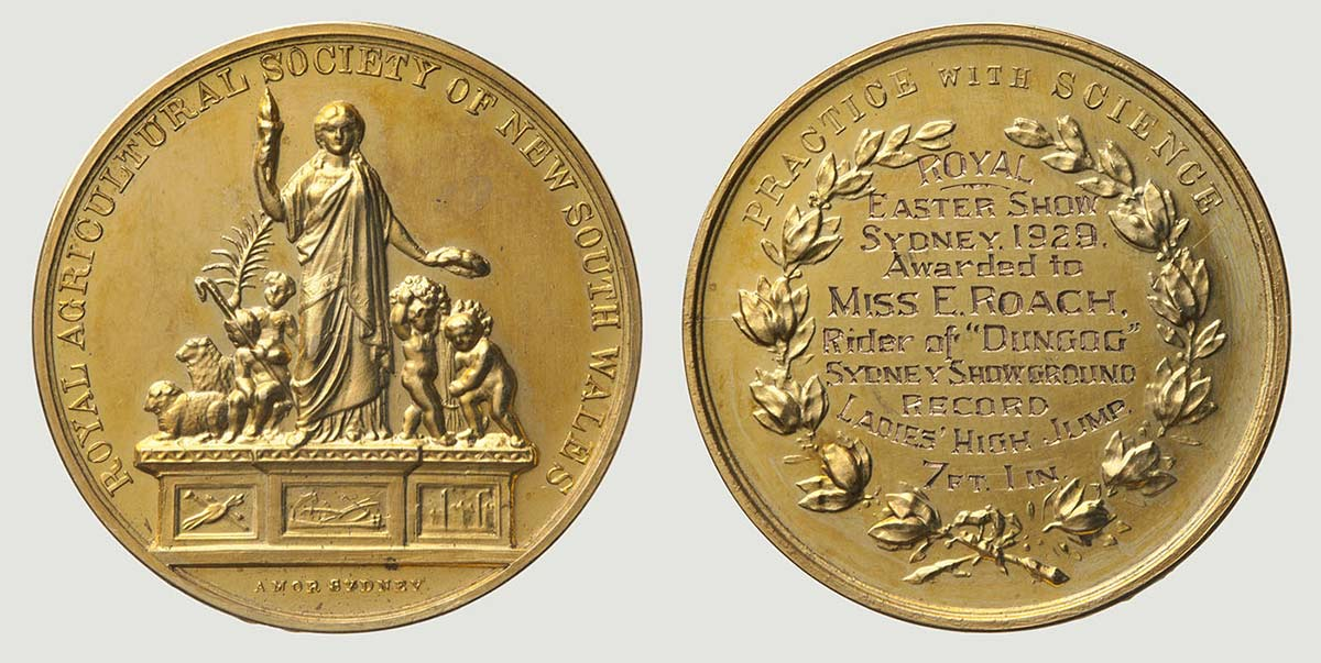 A circular gold coloured metal medal, featuring a relief picture of a figure, possibly a muse of agriculture standing atop a pedestal amongst four smaller figures bearing symbols of agriculture such as wheat sheaf and livestock. Embossed around the circumference of the medal is text that reads 'ROYAL AGRICULTURAL SOCIETY OF NEW SOUTH WALES', and at the bottom are the manufacturers marks 'AMOR SYDNEY'. On the other side of the medal is embossed block text that reads 'PRACTICE WITH SCIENCE' around the top edge. Within a relief laurel wreath are the engraved markings 'ROYAL / EASTER SHOW / SYDNEY 1929 / Awarded to / MISS E. ROACH. / Rider of 'DUNGOG' / SYDNEY SHOWGROUND / RECORD / LADIES HIGH JUMP. / 7FT.1IN.' - click to view larger image