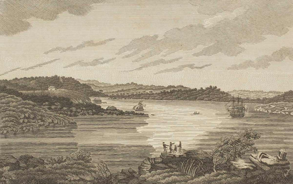 Black and white drawing of a harbour with two sailing ships in the distance and a group of men gathered on a headland in the foreground. - click to view larger image