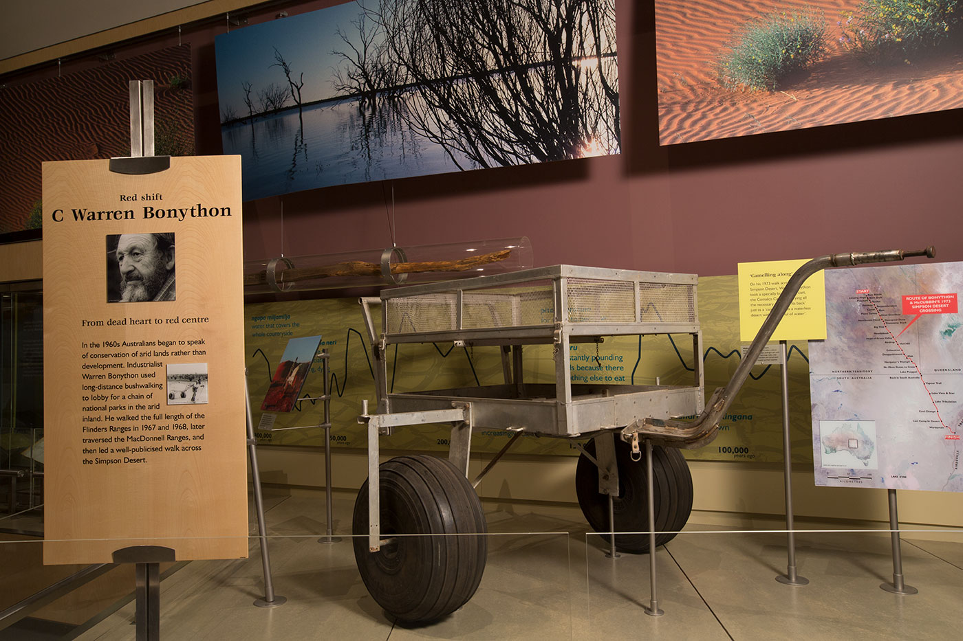 A metal frame on two large tyres, on show in an exhibition. - click to view larger image