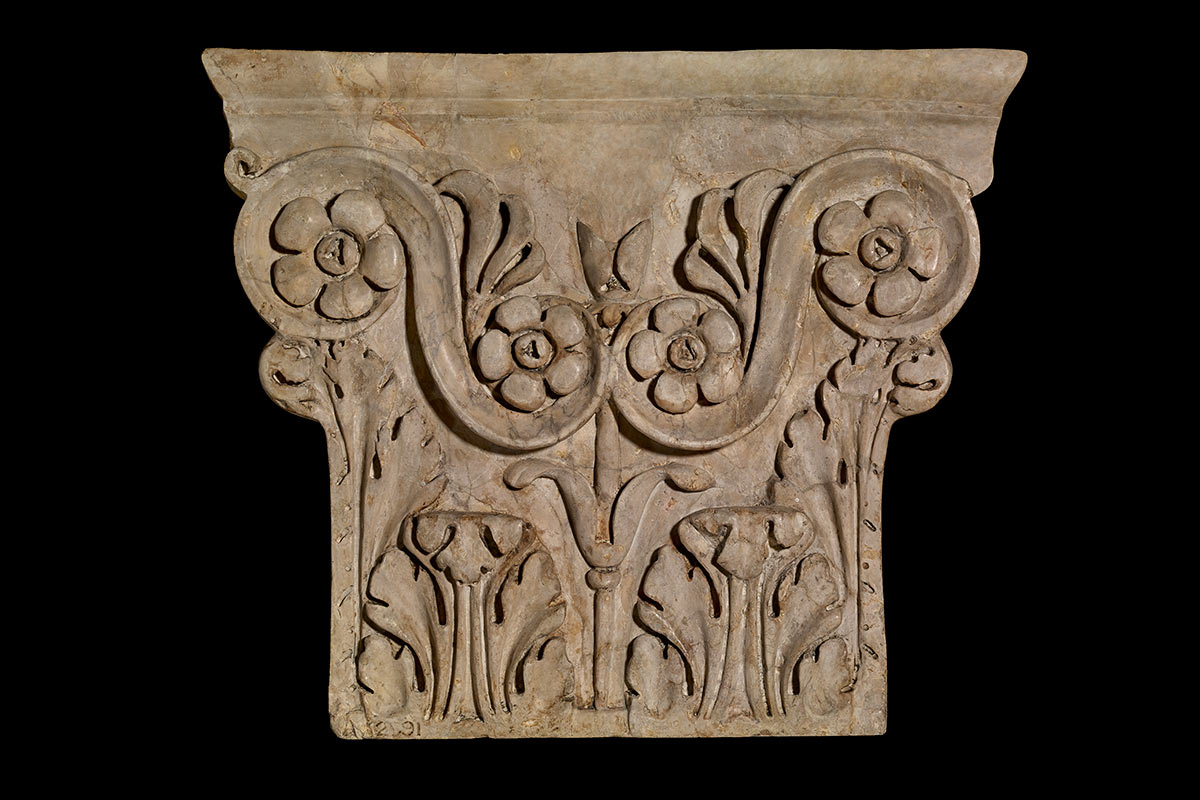 Stone with finely carved features. - click to view larger image