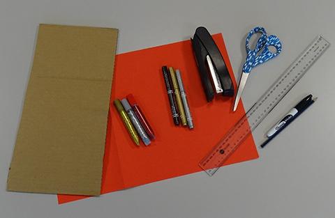 Coloured paper, stapler, scissors, pens and ruler