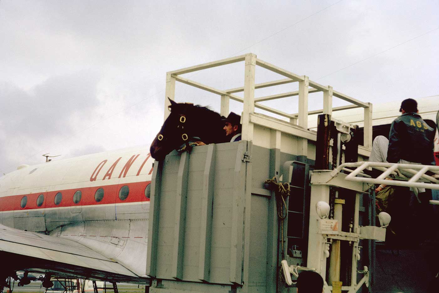 Neale helping to load Mirrabooka for the flight from Heathrow to Rome, 1960. - click to view larger image