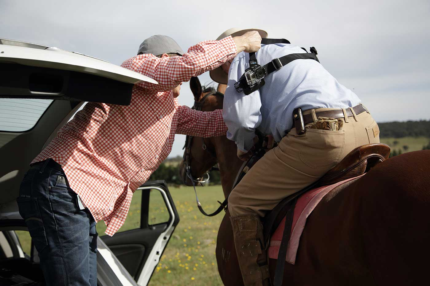 Jeremy Lucas assisting Neale Lavis to mount the Go Pro, December 2013. - click to view larger image
