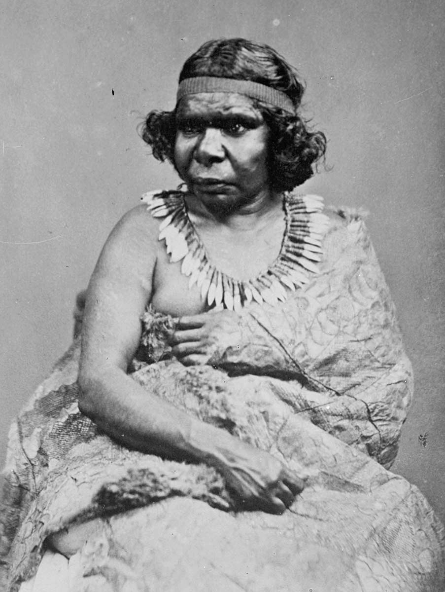 Black and white portrait of an Indigenous Australian woman in traditional clothing. - click to view larger image