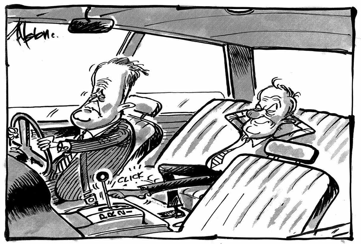 A black and white cartoon depicting Malcolm Turnbull, looking resigned and wearing a pin-striped business suit, sits at the wheel of a car, as a gleeful Peter Costello reclines in the back seat. Mr Costello's left leg is extended forward to move the car's gears into place. - click to view larger image