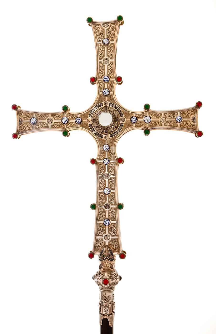 Golden cross with ornate Celtic design and gemstones. - click to view larger image