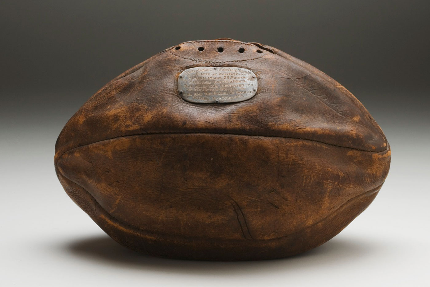 Football with small commemmorative plaque on side. - click to view larger image