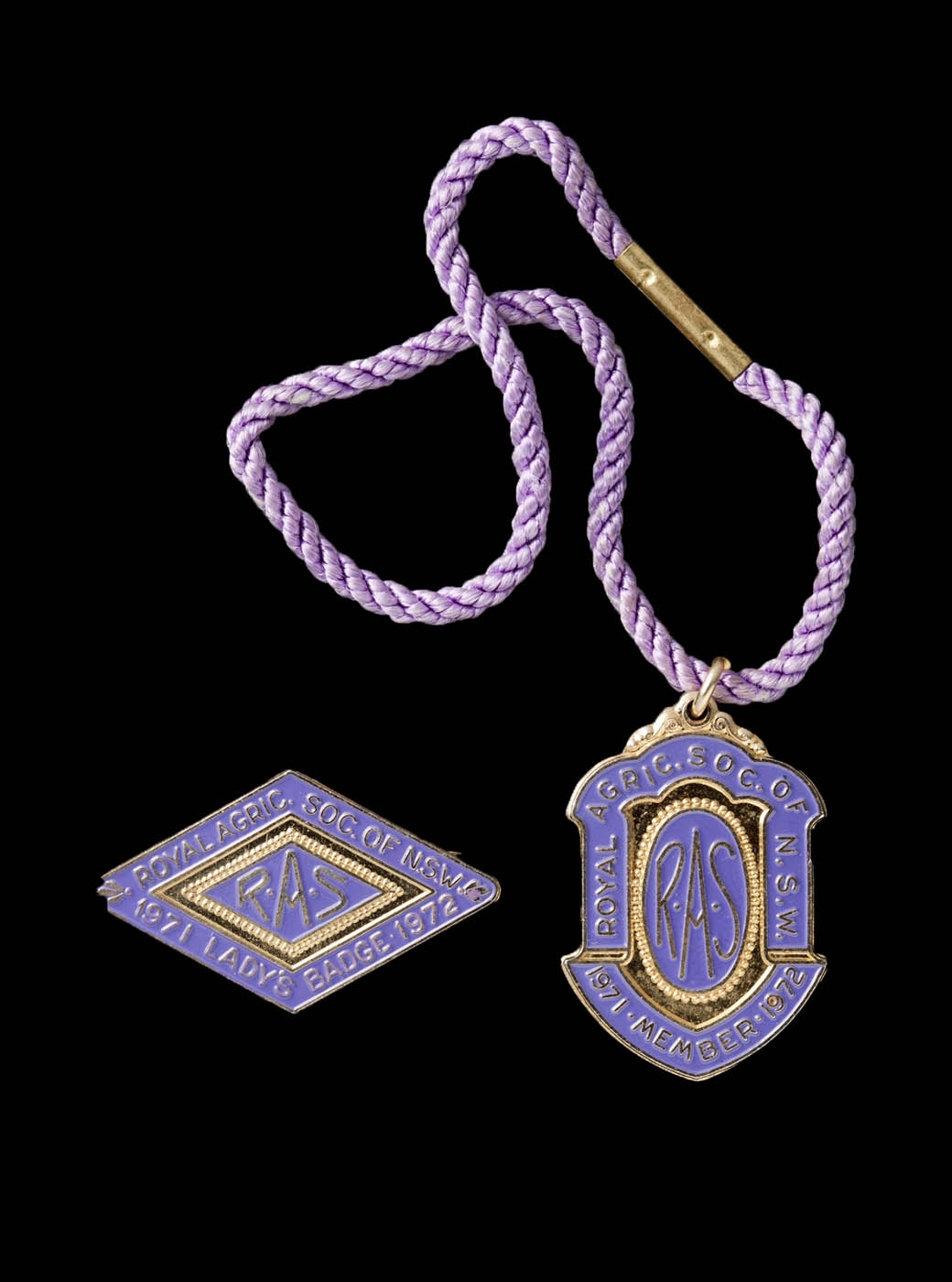 Royal Agricultural Society of N.S.W. members badge, attached to a purple cord, and ladies badge, 1971-72 - click to view larger image