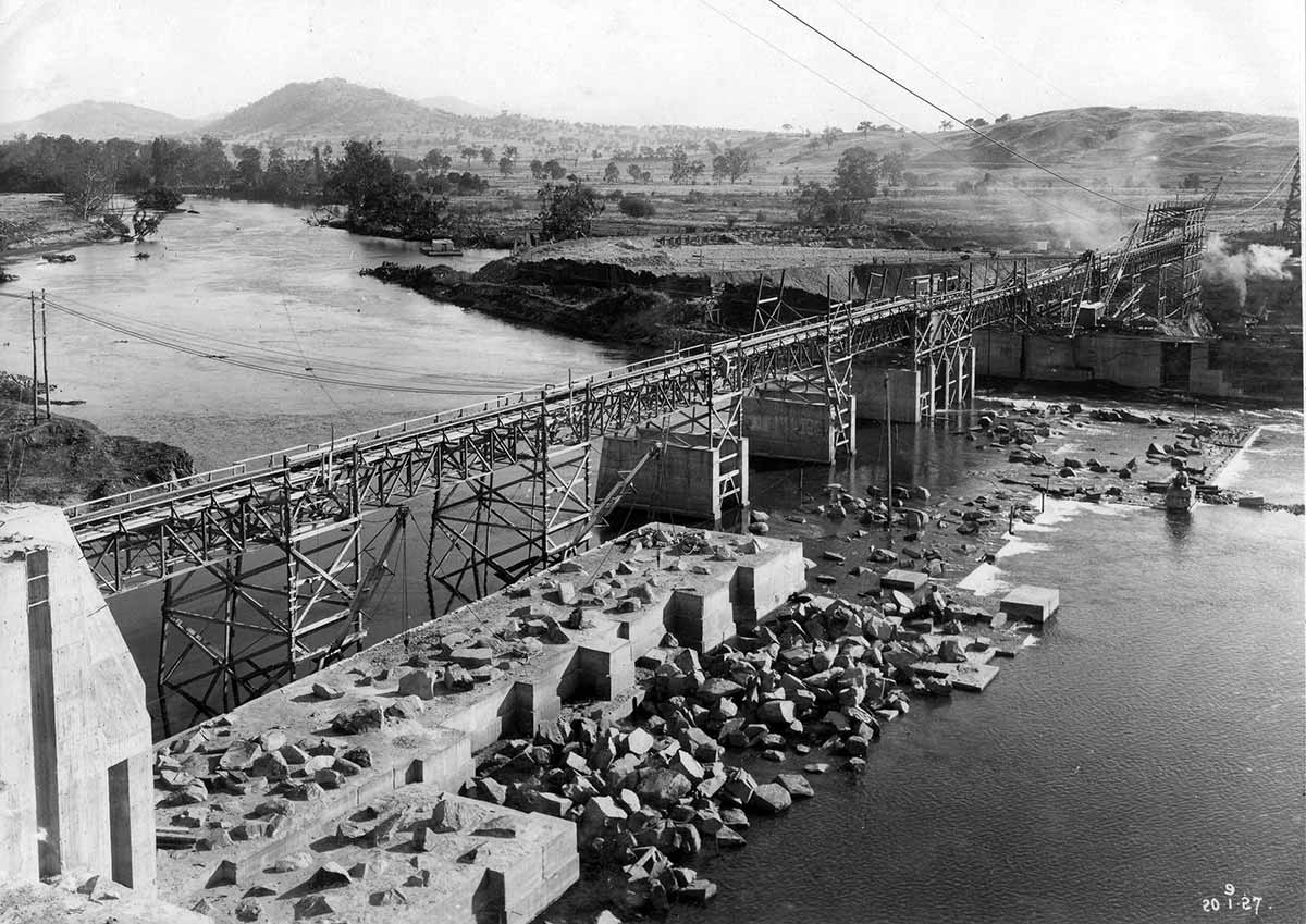 Black and white photograph of a dam under construction.