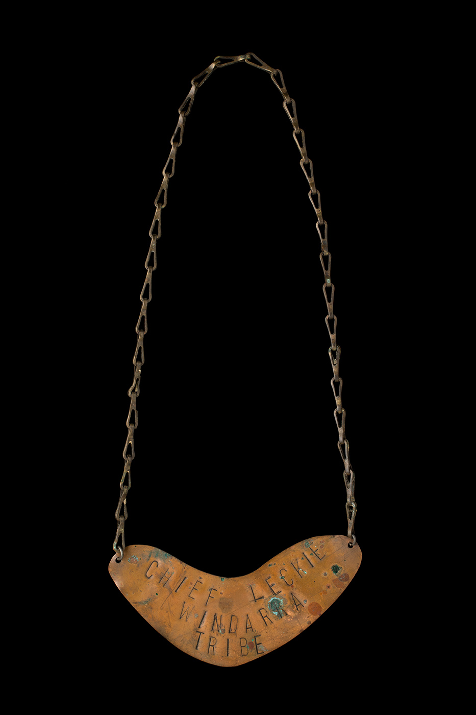 Engraved breastplate with a long chain. - click to view larger image