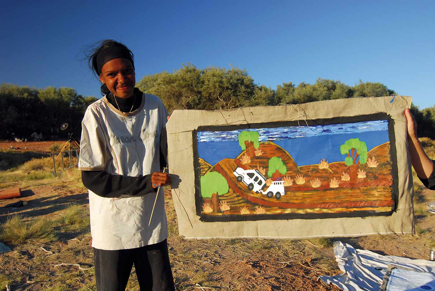 Hayley Atkins with her painting Me, Milly and Gabrielle Got Bogged, painted at Well 36.