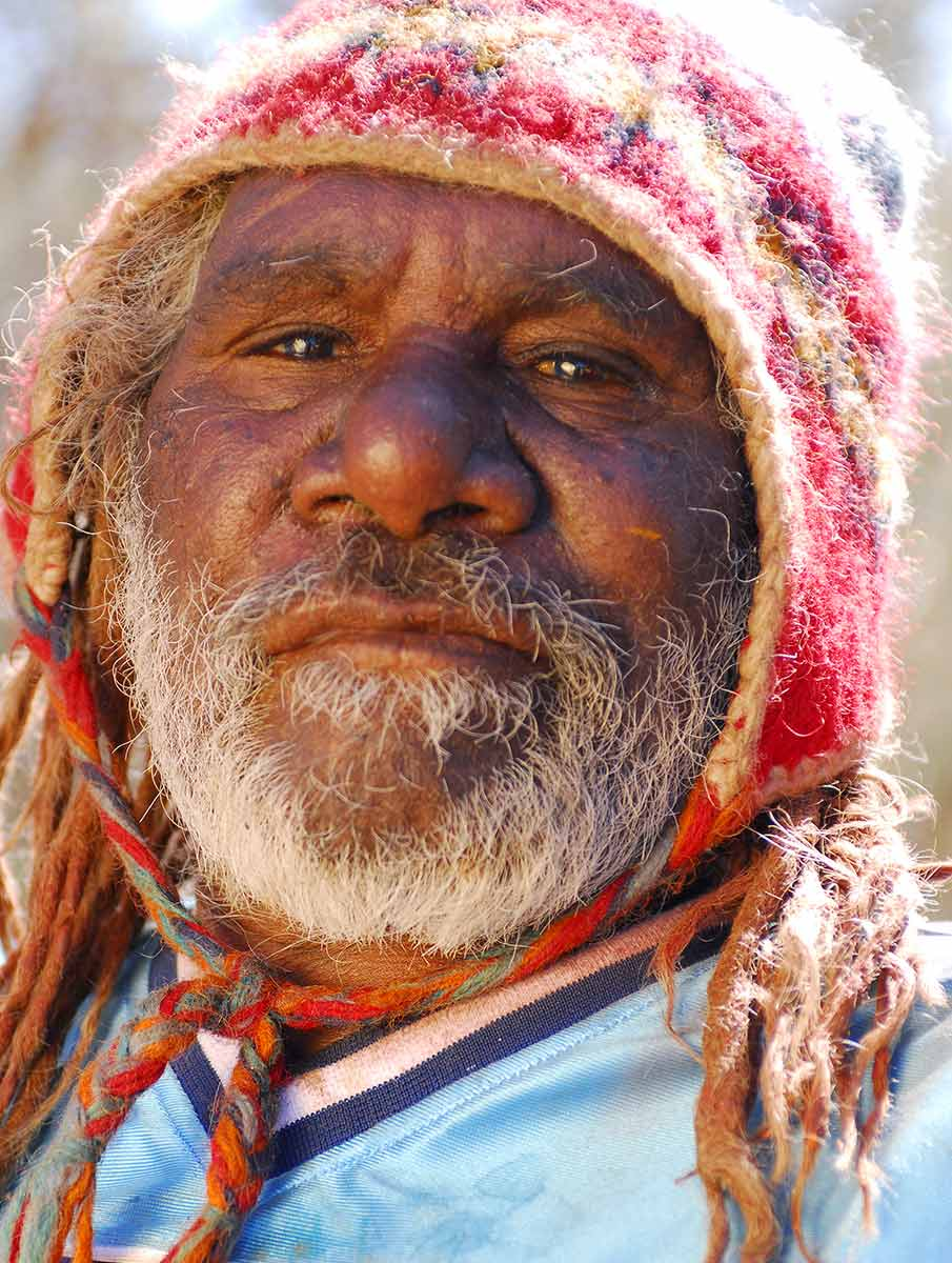 Portrait of Patrick Olodoodi (Alatuti) Tjungurrayi. - click to view larger image