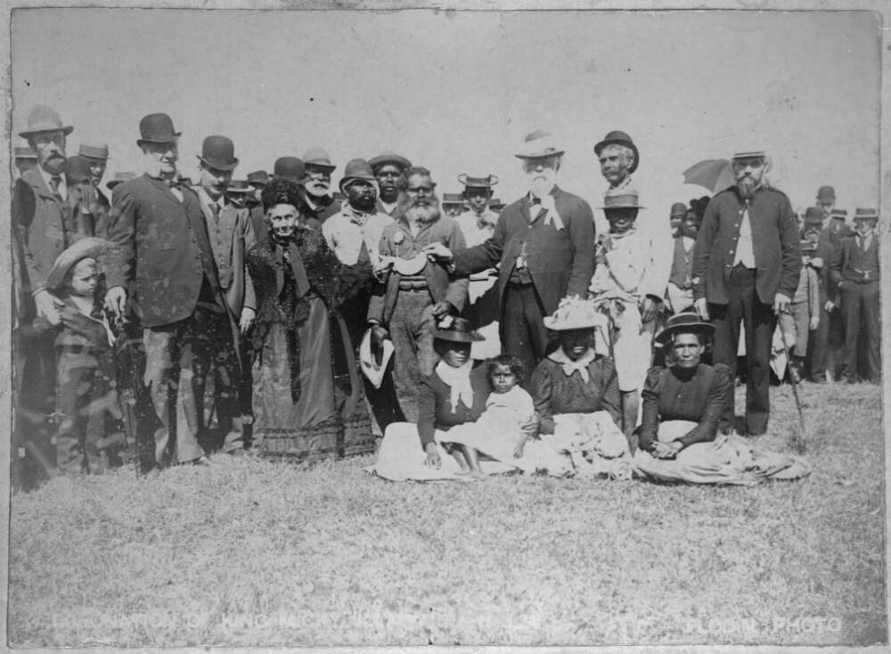 Black and white photograph of a group portrait of people wearing late 19th century clothing.